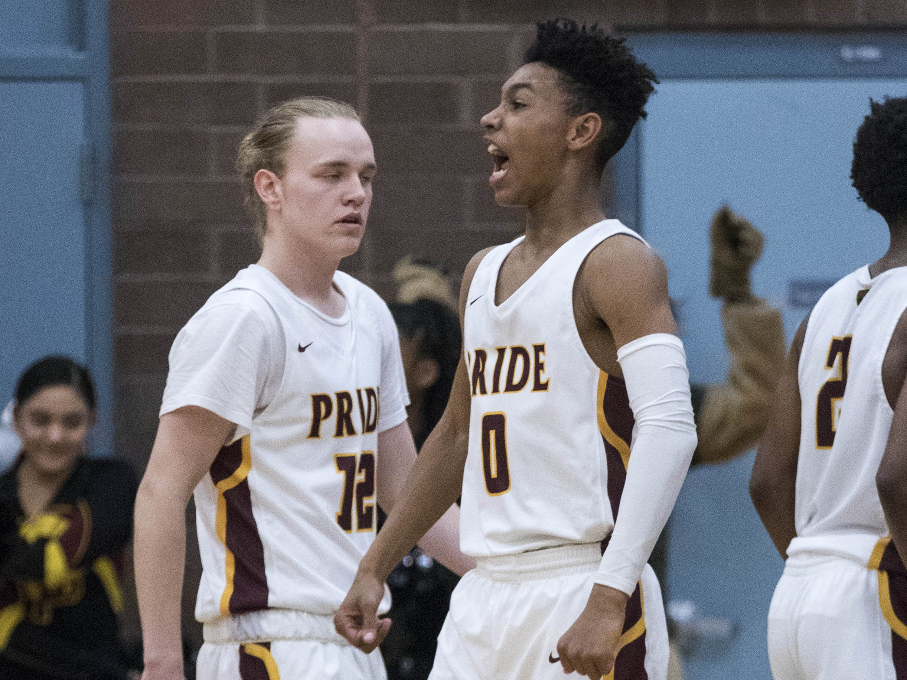 Mountain Pointe's Jason Kimbrough (0) hollers out to the student section after hitting a three point shot against Desert Vista's during their game in Phoenix on Tuesday, Jan. 29.