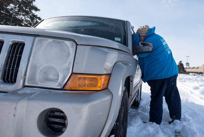 Tricia Almanza, street outreach coordinator for The Harbor, looks through the window of a car Wednesday, Jan. 30, 2019. Almanza is looking for any signs that someone may be living in the vehicle. The search was conducted as part of a nationwide effort to survey local populations.