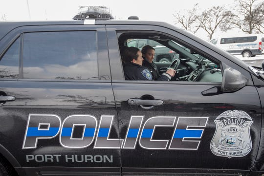 Port Huron Police Officer Adrianne Mynsberge, left, helps Ashley Marcano file a report while on patrol Tuesday, Jan. 29, 2019 in Port Huron.