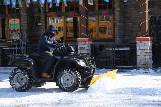 Germand Perez plows the parking lot at Cafe Maya in the Village of Wappingers Falls on January 30, 2019.