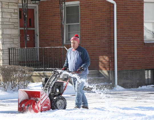 David Garmot clears the snow from his driveway in the Town of Poughkeepsie on January 30, 2019.
