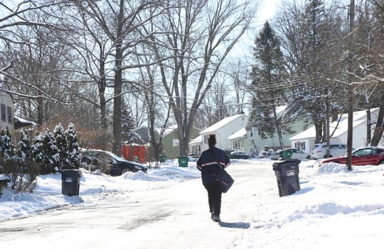 Letter carrier Kim Hartmann delivers mail Liss Road in the Village of Wappingers Falls on January 30, 2019.