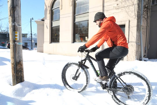 Mario Centuori takes the opportunity to ride his fat bike in the snow on Market Street in the Village of Wappingers Falls on January 30, 2019.