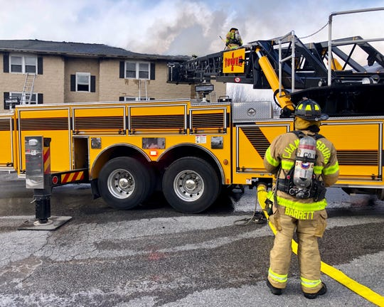 Crews work on a fire the afternoon of Wednesday, Jan. 30, 2019 at an apartment complex on Byers Avenue.