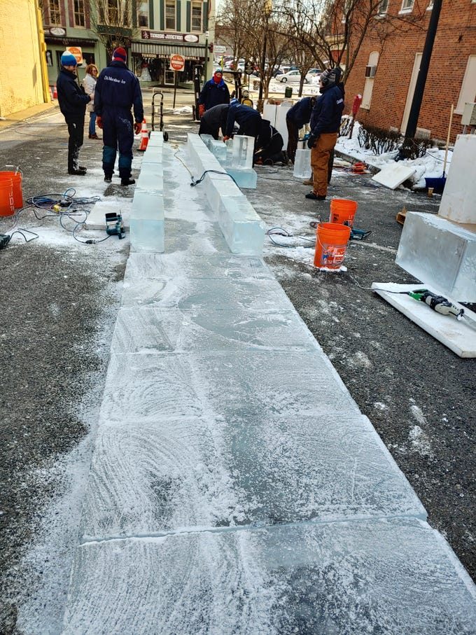 The first half of the 40-foot-long, double-wide ice slide, a popular IceFest attraction, comes together around 9:30 a.m. Wednesday, Jan. 30, 2019, in the parking lot next to Gartenberg Jewelry on South Main Street. DiMartino Ice Company had most of the second half built less than 10 minutes after this photo was taken. The free ice slide is open all through IceFest, 5-8 p.m. Thursday, Jan. 31 and Friday, Feb. 1; 10 a.m. to 8 p.m. Saturday, Feb. 2; and noon to 4 p.m. Sunday, Feb. 3. For a full IceFest schedule, go to icefestpa.com.