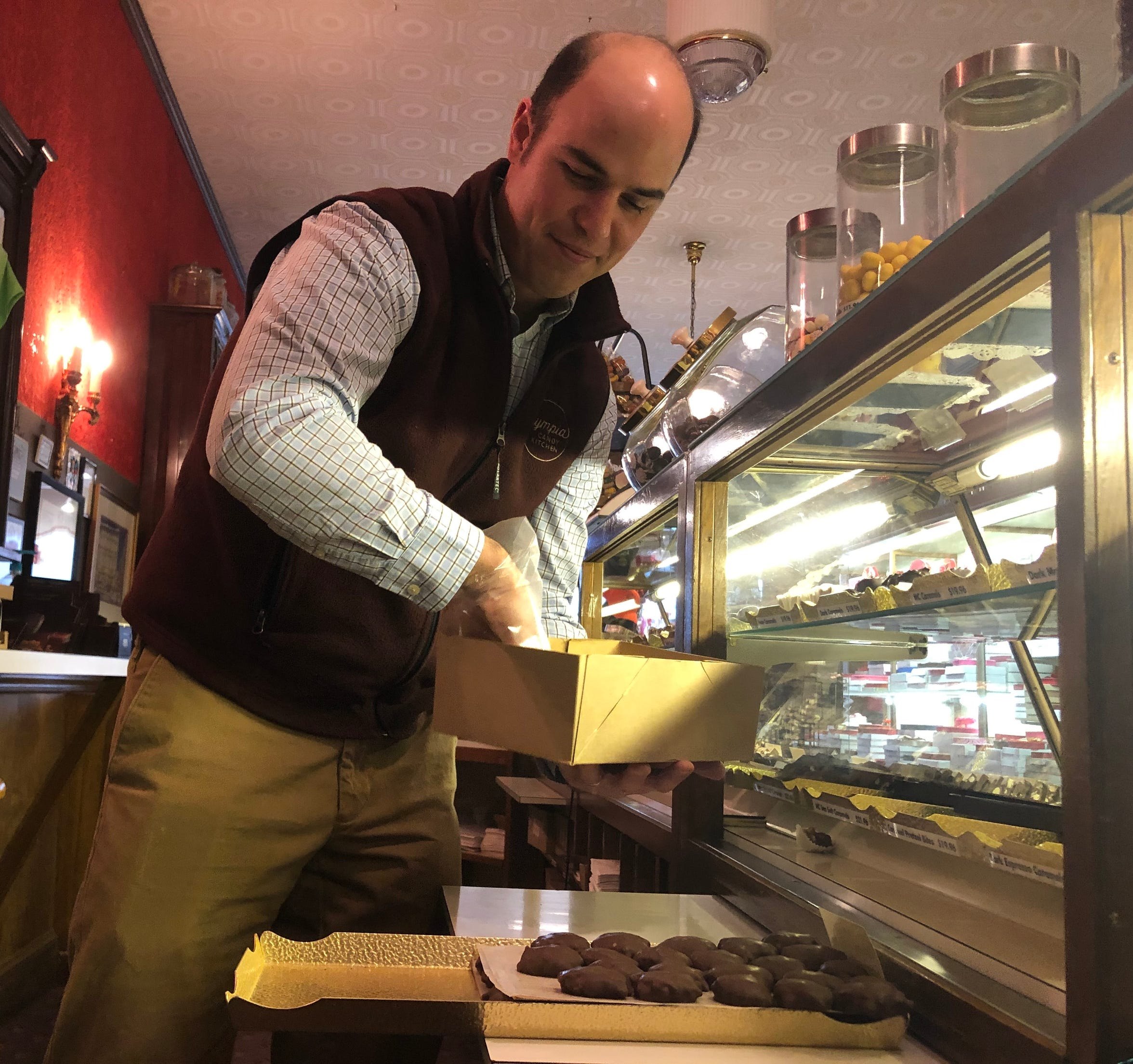 Tony Pananes, owner of Olympia Candy Kitchen, prepares chocolate candies to be put in the case the morning of Thursday, Jan. 24, 2019. The candy store is one of three others that have been operating in downtown Chambersburg for more than 100 years.