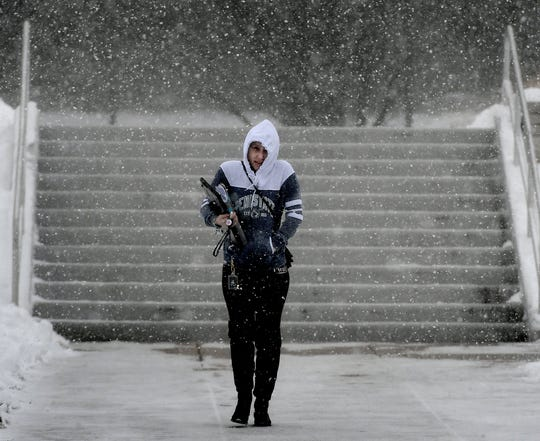 Penn State York student Shantel Rivera, of York City, walks to her car on campus during a snow squall Wednesday, Jan. 30, 2019. Classes at the college were delayed, starting at 10 a.m. Weather conditions resulted in several school closings and delays Wednesday. Bill Kalina photo