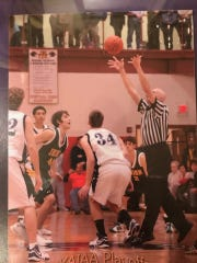 Dave Concino is shown here throwing up a jump ball for a York-Adams League playoff game.