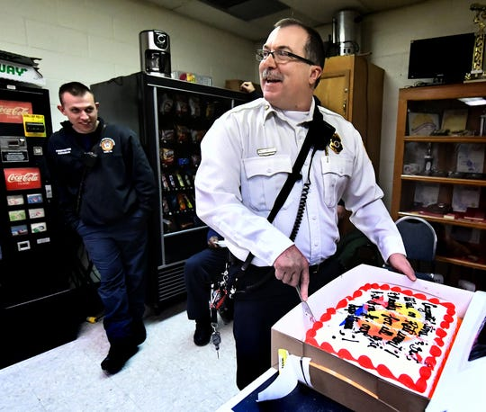 Retiring York City Fire Department Chief David Michaels talks with firefighters, including firefighter Mac Cochran, left, while cutting his cake during a luncheon for him at Vigilant Fire Company Wednesday, Jan. 30, 2019. Michaels has been with the York City Fire Department for nearly 29 years. Bill Kalina photo