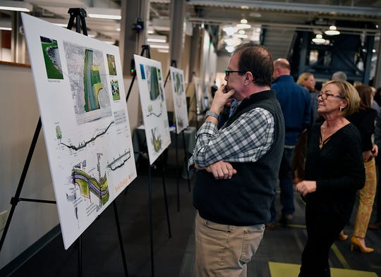 Joe Musso looks at renderings of proposed improvements along the Codorus Creek through York City during a open house hosted by the York County Economic Alliance and Buchart Horn, Tuesday, January 29, 2019. 