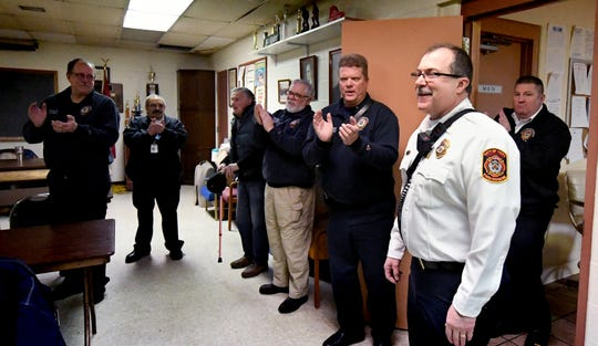 York City Fire Department members applaud retiring Chief David Michaels during a luncheon for him at Vigilant Fire Company Wednesday, Jan. 30, 2019. Michaels has been with the York City Fire Department for nearly 29 years. Bill Kalina photo