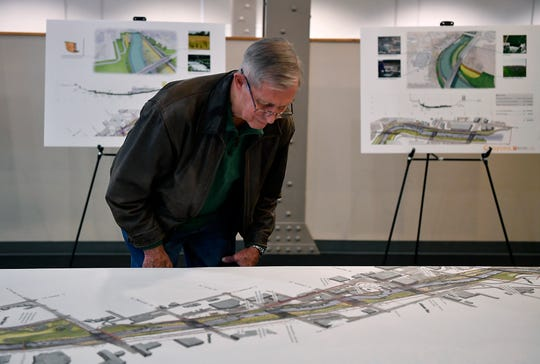 Retired businessman Charlie Snyder takes a close look at schematic designs of proposed improvements to the Codorus Creek corridor during a York County Economic Alliance and Buchart Horn public open house, Tuesday, January 29, 2019. John A. Pavoncello photo