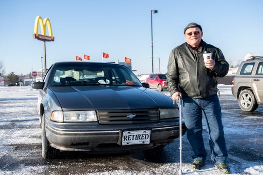 Glenn Hamberger, 66, poses in front of his 1994 Chevy Lumina, which he has lived in on-and-off since November. The car was his father's, and has over 200,000 thousand miles on it.