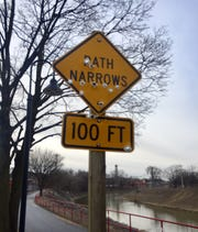 This sign along the rail trail in York City was riddled with bullet holes. The city has since replaced the sign.