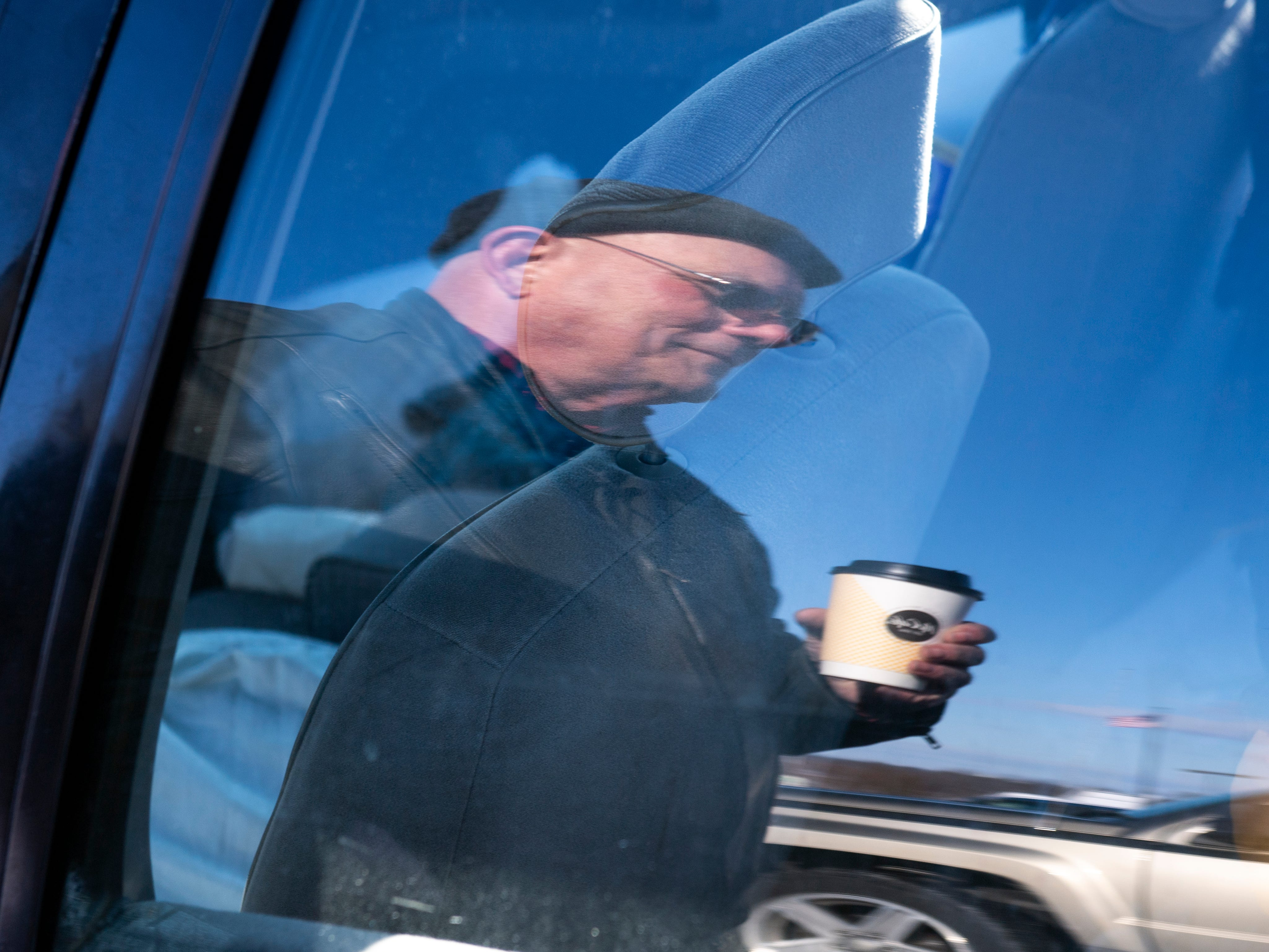 Glenn Hamberger's reflection is seen as he talks about the challenges of living in his car through the harsh of winter, Wednesday, Jan. 30, 2019. Hamberger, 66, has been living in his 1994 Chevy Lumina on-and-off since Nov.