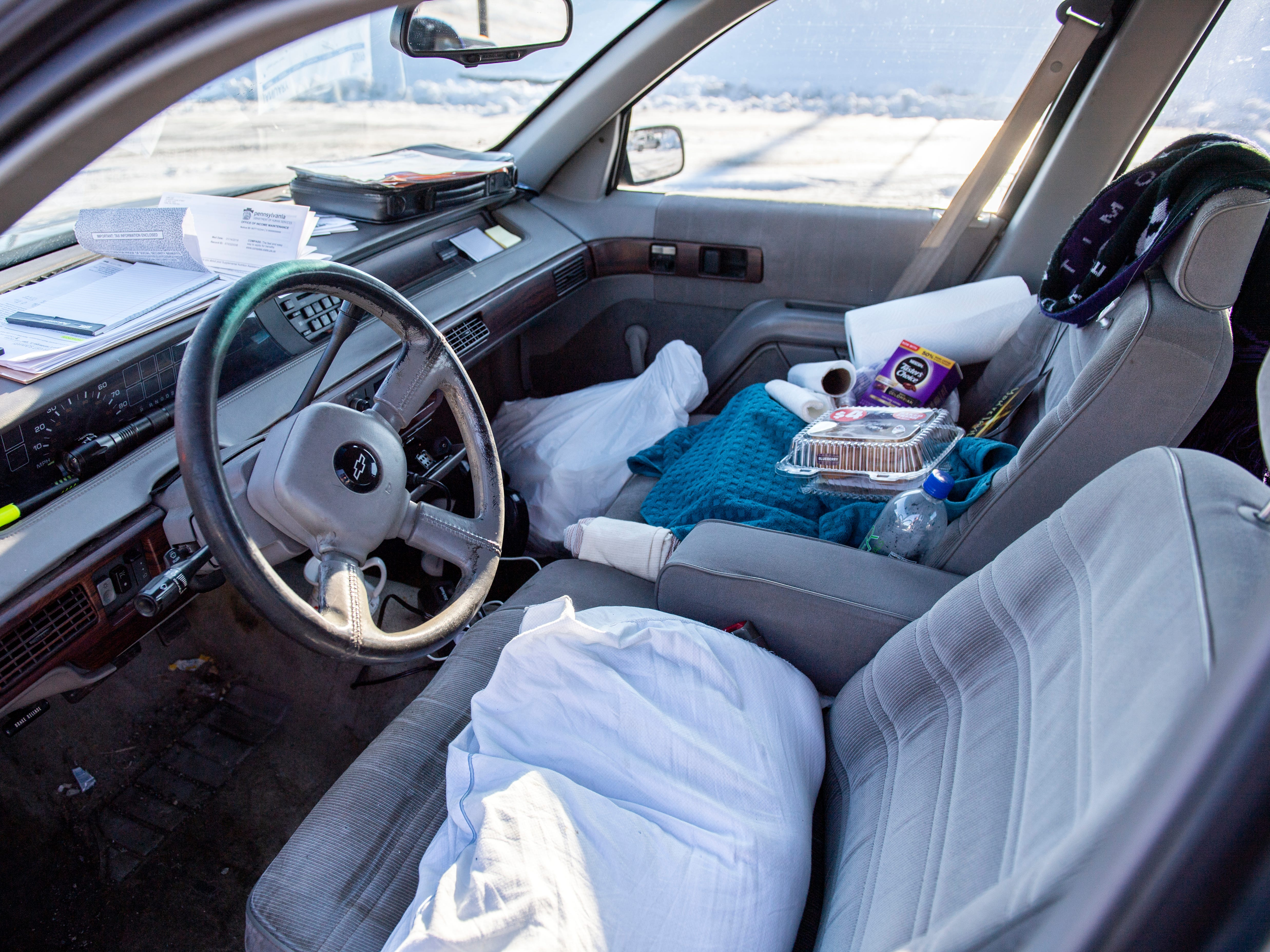 Glen Hamberger, 66, calls his 1994 Chevy Lumina home. It's where he has slept, eaten and passed the time, on-and-off since November, but he hopes to be employed again soon.