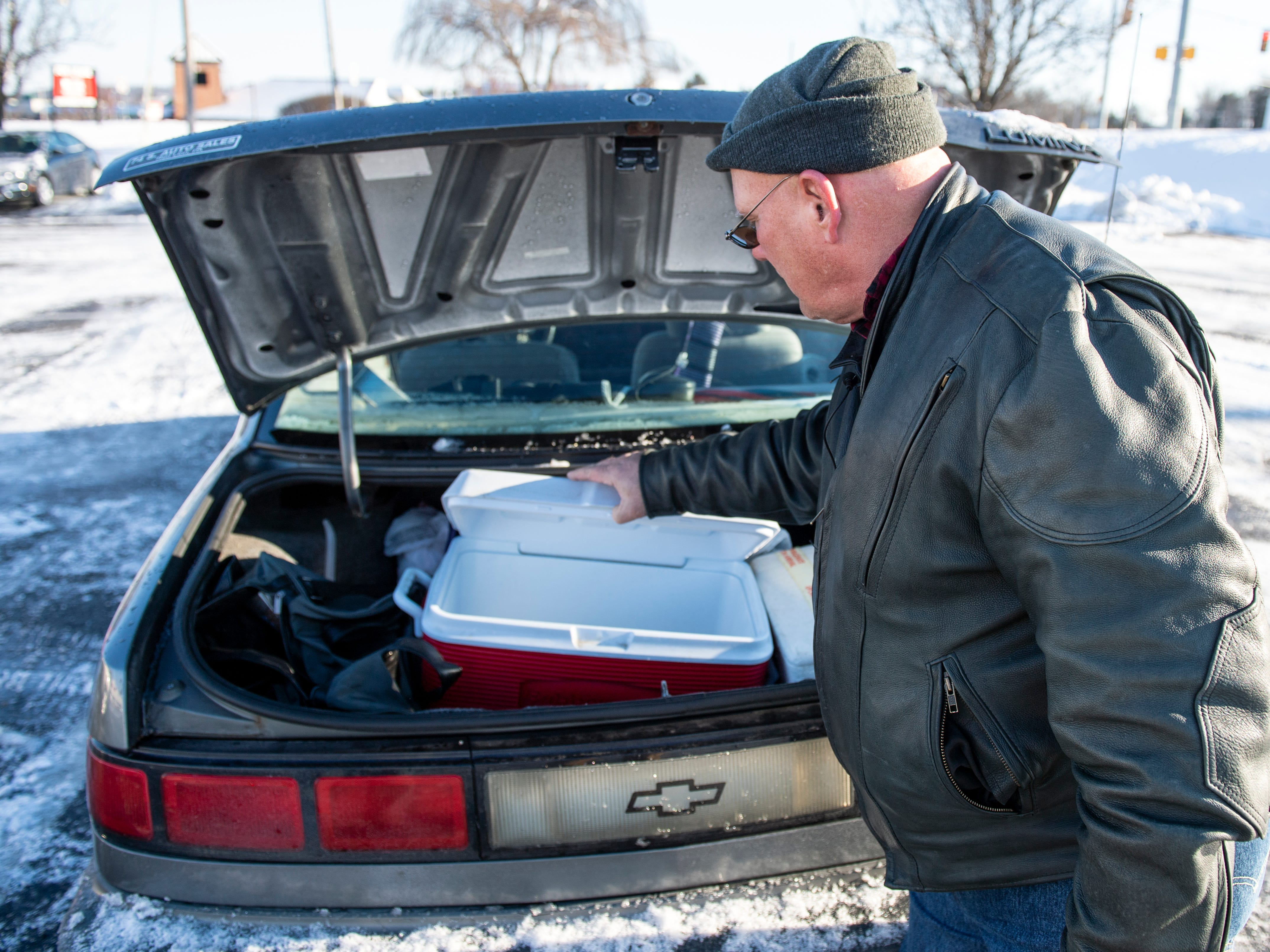 Glenn Hamberger, 66, looks through the cooler in the back of his 1994 Chevy Lumina, parked along Cape Horn Rd., Wednesday, Jan. 30, 2019. Hamberger has been living in car on-and-off since Nov.