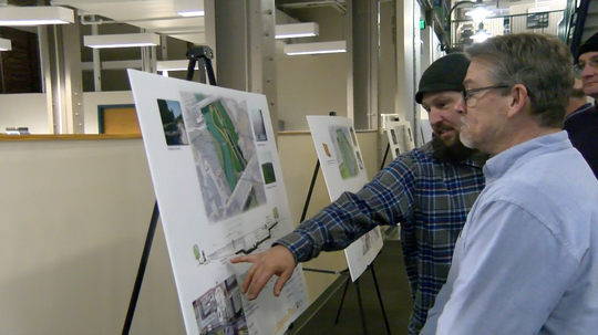 Two men discuss the makeover plans for the Codorus Creek. The public got to see the revitalization plans for the first time at an open house on January 29, 2019.