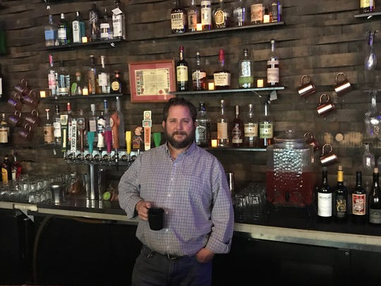 Matt Polley is transferring his interest in the Jungle coffee bar, which he has owned for nearly 18 years. He is keeping the sister Jungle wine and cocktail bar, shown here, and turning it into a lounge-y downtown hangout.