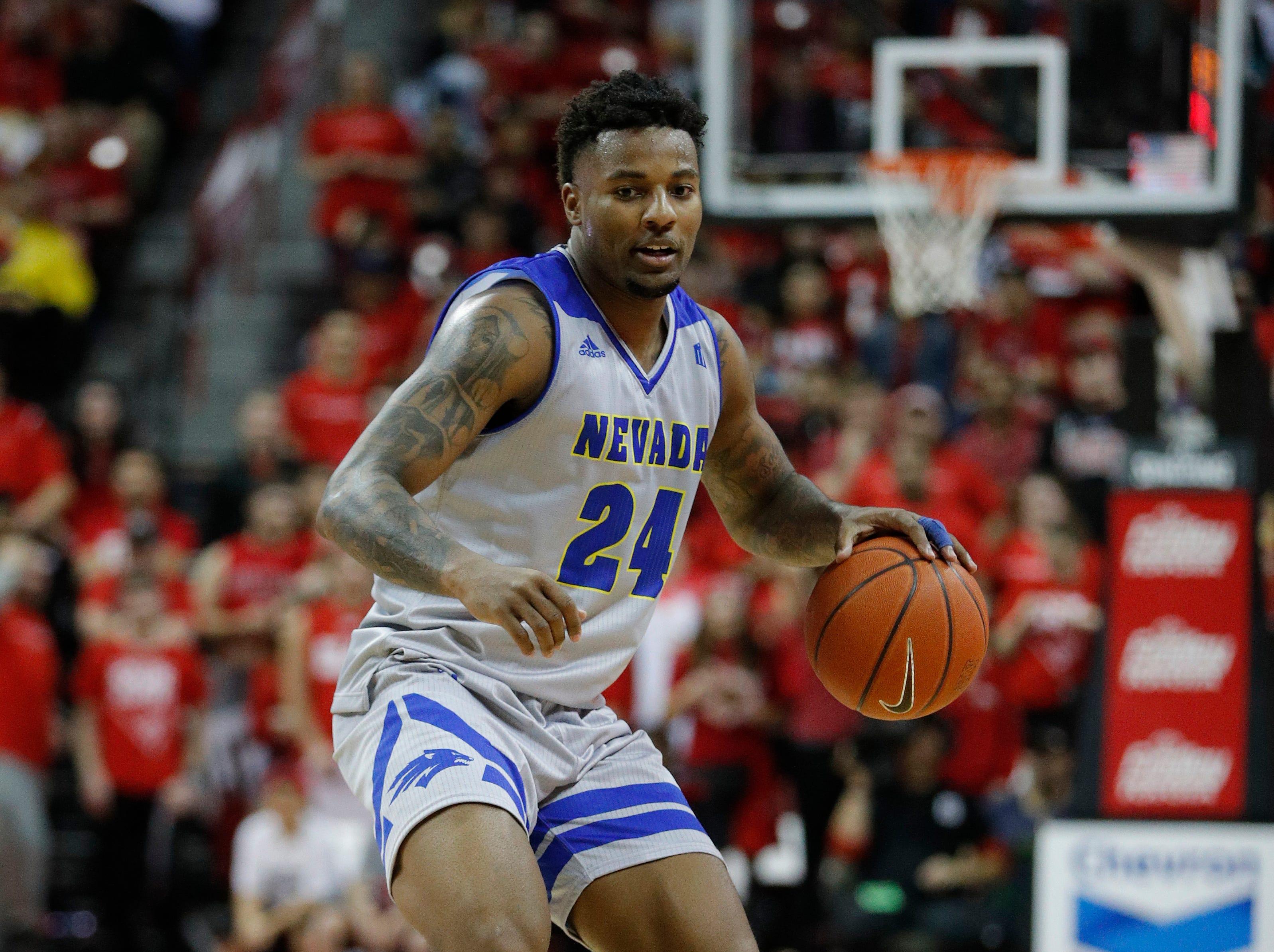 Nevada's Jordan Caroline (24) plays against UNLV during the second half of an NCAA college basketball game Tuesday, Jan. 29, 2019, in Las Vegas. Nevada won 87-70. (AP Photo/John Locher)