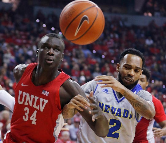 UNLV's Cheikh Mbacke Diong, left, and Nevada's Corey Henson battle for a rebound during the first half of Tuesday's game.