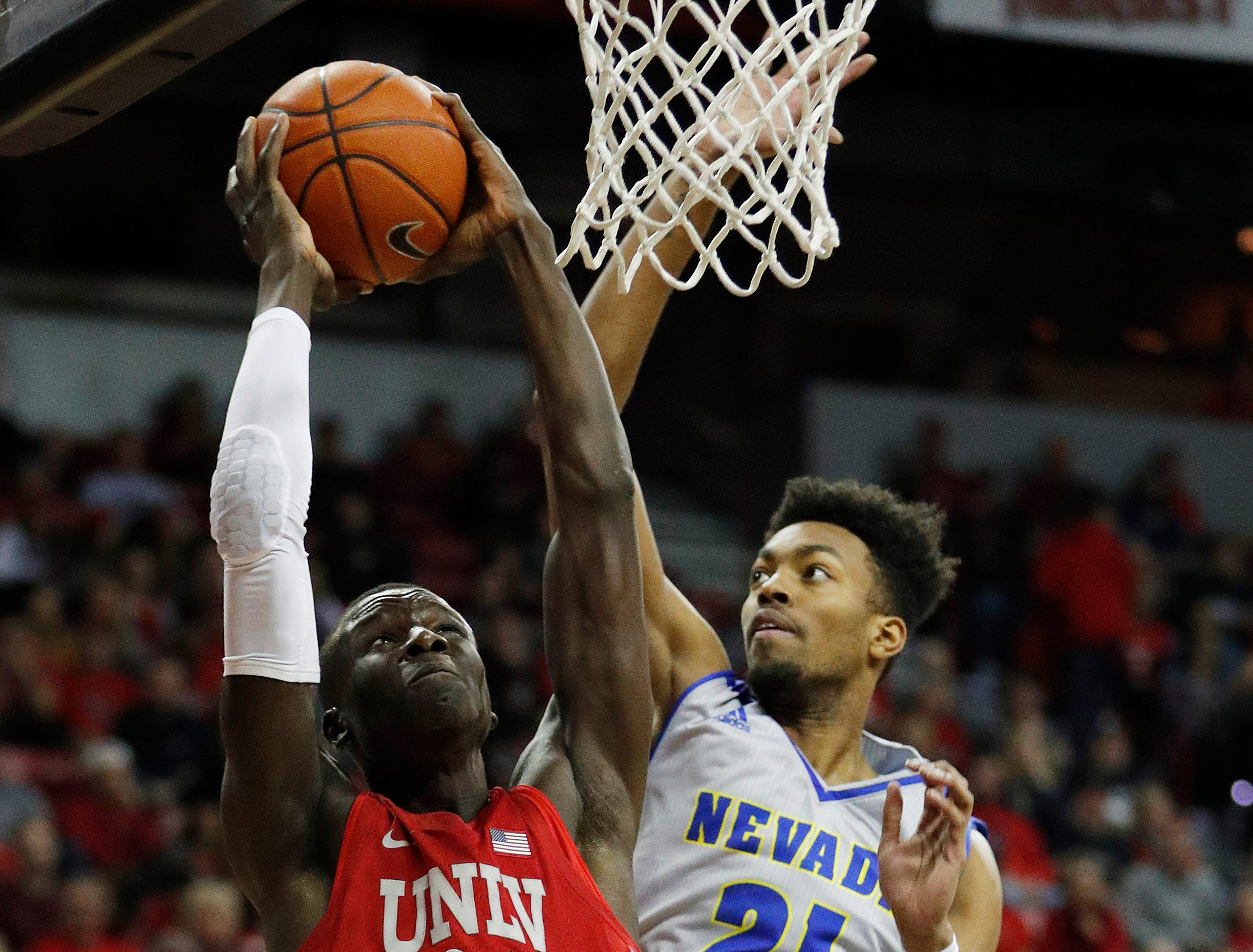 UNLV's Cheikh Mbacke Diong (34) shoots against Nevada's Jordan Brown during the first half of an NCAA college basketball game Tuesday, Jan. 29, 2019, in Las Vegas. (AP Photo/John Locher)