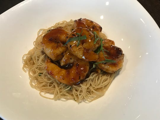 Soy sauce shrimp with ginger scallion noodles from Kwok's Bistro 2019 Chinese New Year dinner celebrating the Year of the Pig.