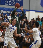 Hug's Levi Williams-Smith shoots while taking on McQueen during their basketball game at McQueen on Jan. 25, 2019.