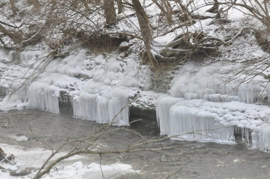 Ice has formed along the Whitewater River near Thistlethwaite Falls.