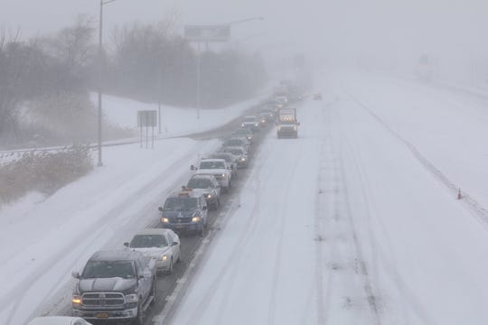 Traffic on 390 southbound in Rochester is directed off at Brooks Avenue as whiteout conditions close the highway.