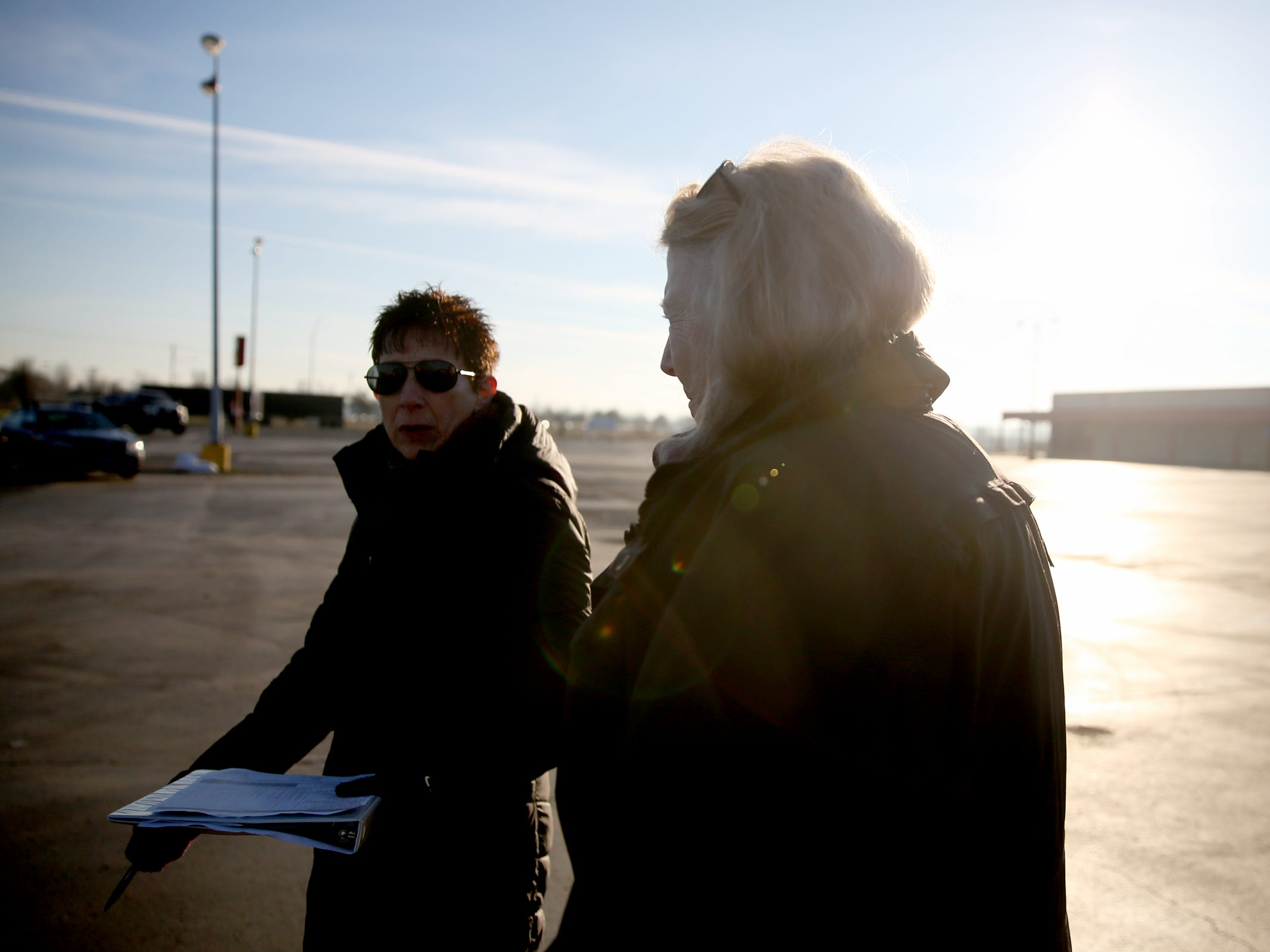 Volunteers Pamella Watson, left, and Lorrie Walker walk through the former Kmart parking lot, looking for people to interview for the annual Point-in-Time homeless count in Salem on Wednesday, Jan. 30, 2019. The number of people counted helps local programs qualify for federal funds to combat homelessness.