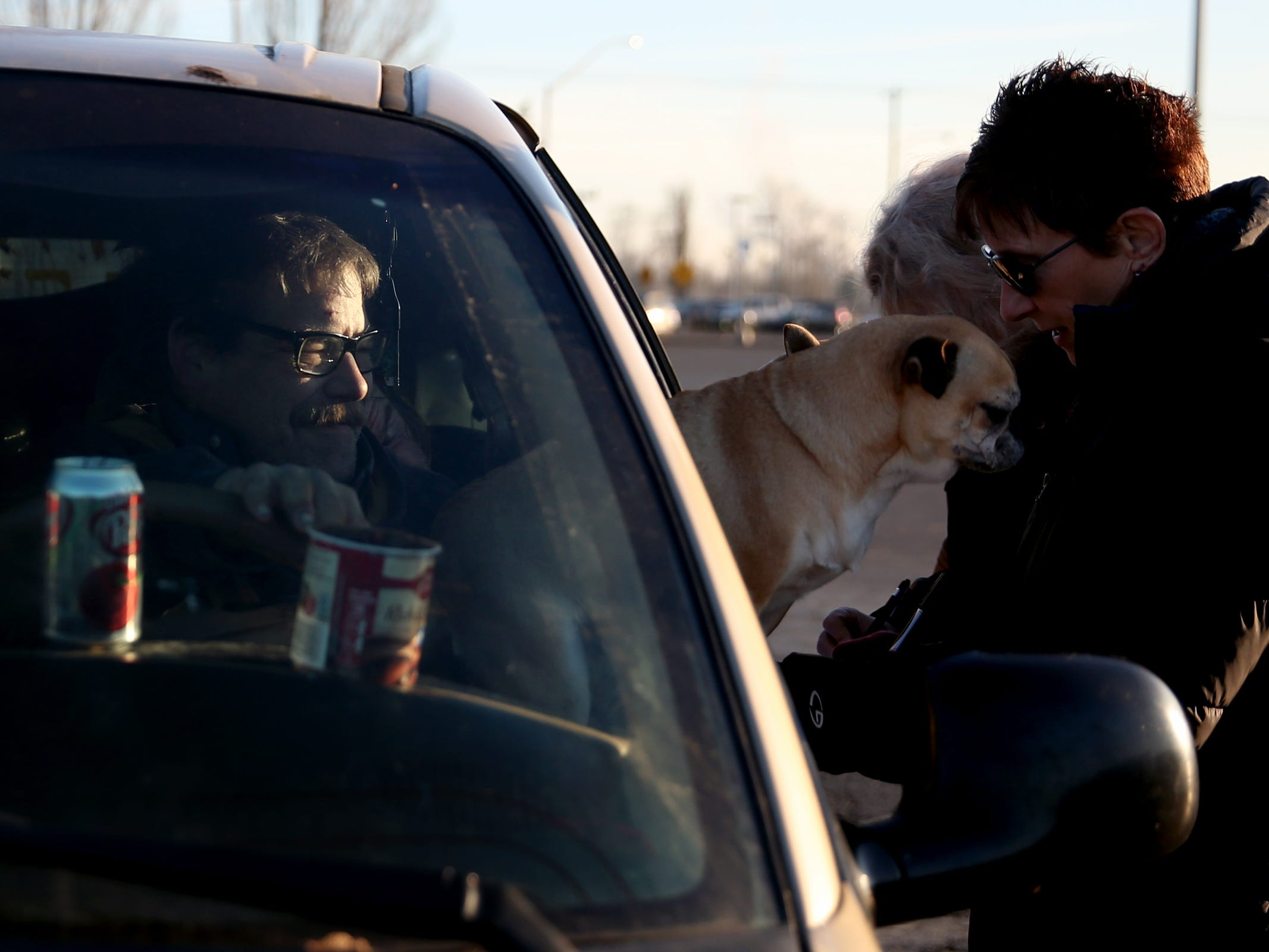 John Yarbough, 57, gives his information to volunteer Pamella Watson as his pug and chihuahua mix Cocoa leans out his van window during the annual Point-in-Time homeless count in Salem on Wednesday, Jan. 30, 2019. The number of people counted helps local programs qualify for federal funds to combat homelessness. He lives in a minivan with another person and two dogs that was parked in the former Kmart parking lot.