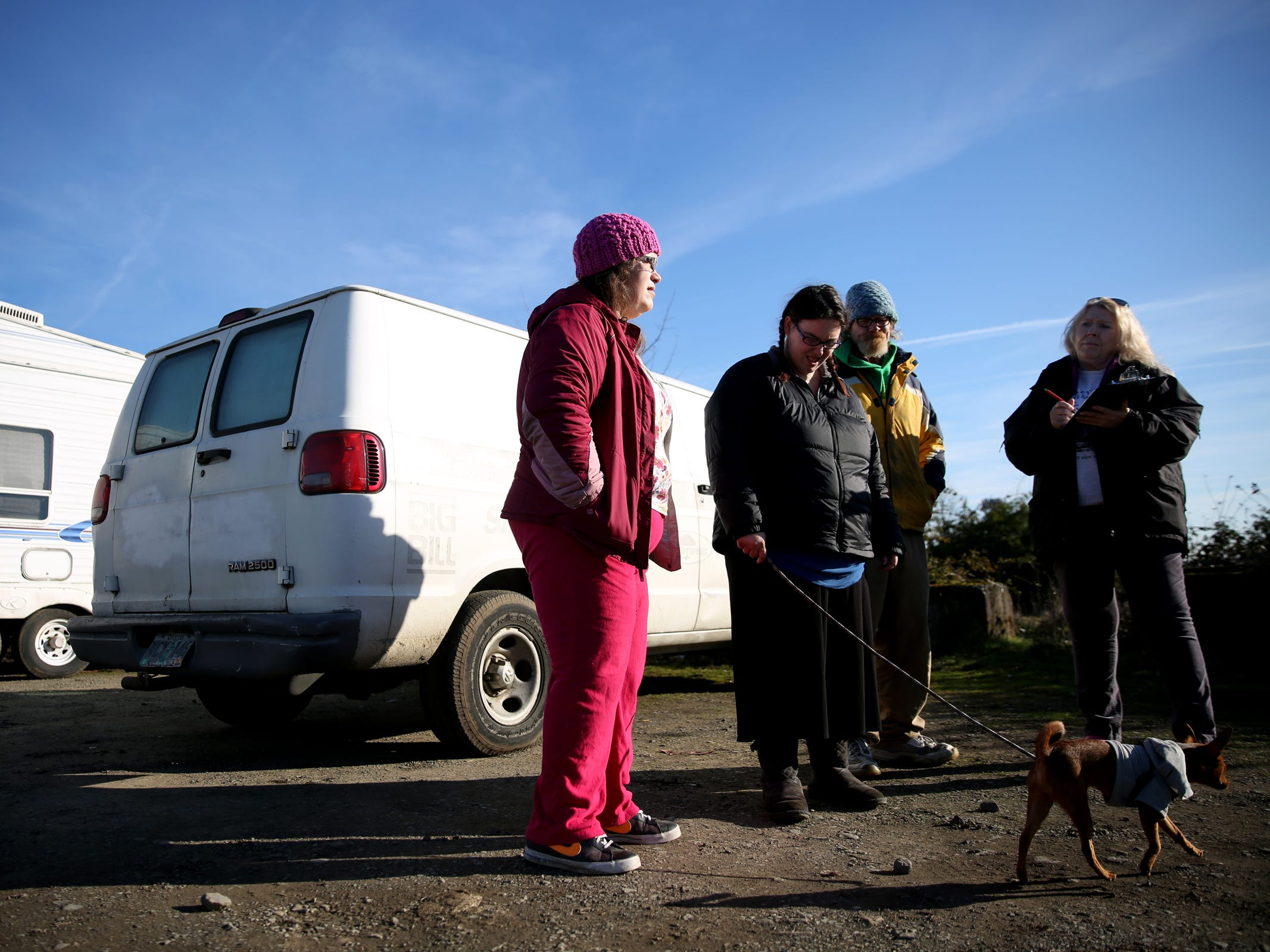 Maria Baker, 41, from left, Cheyanne West, 24, and Dave West, 52, give their information to volunteer Lorrie Walker during the annual Point-in-Time homeless count in Salem on Wednesday, Jan. 30, 2019. The number of people counted helps local programs qualify for federal funds to combat homelessness. They all live out of vehicles.