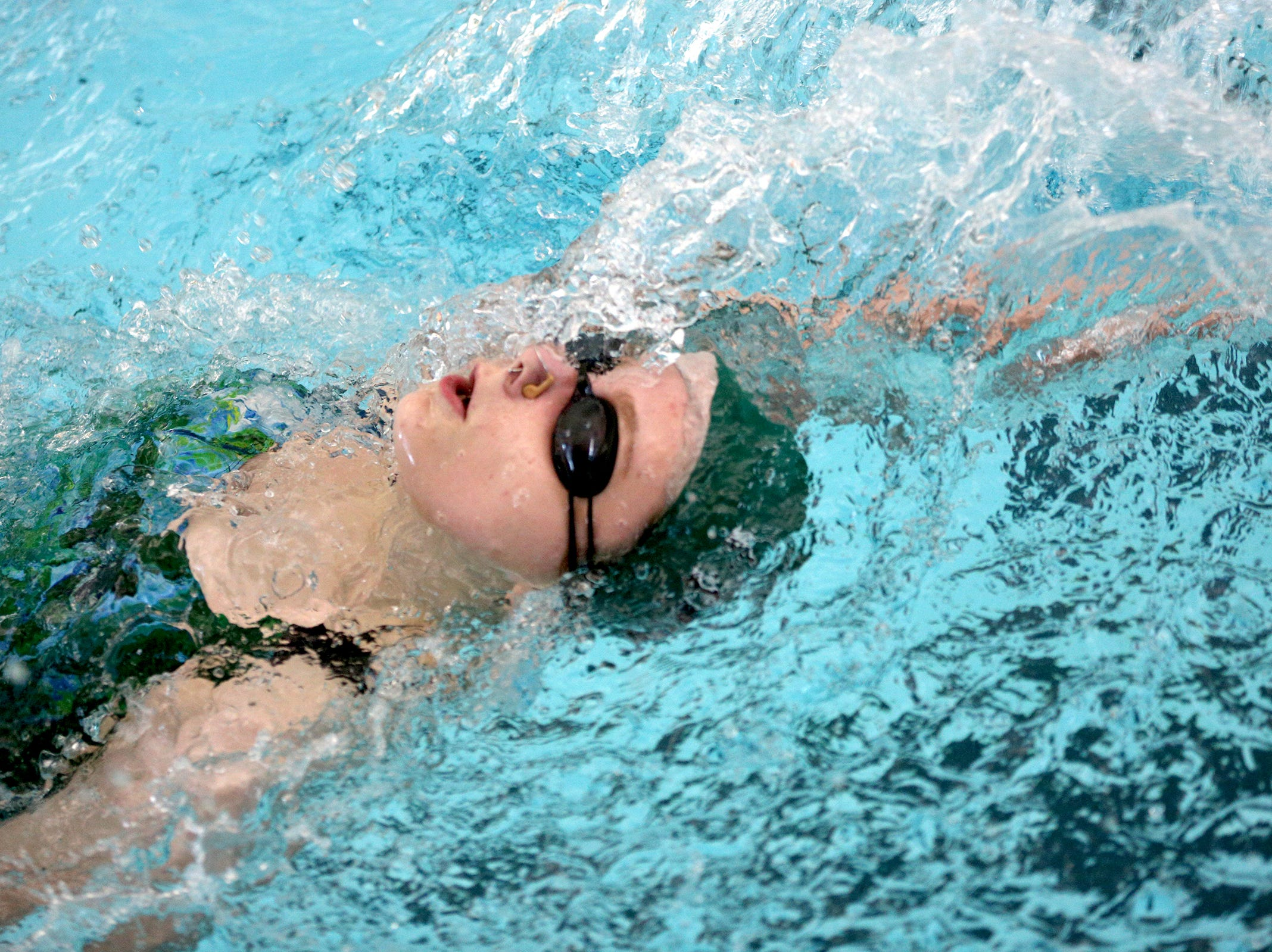 West Salem High School's Aunabella Ward backstrokes during a dual meet against South Salem at the Kroc Center on Tuesday, Jan. 29, 2019.
