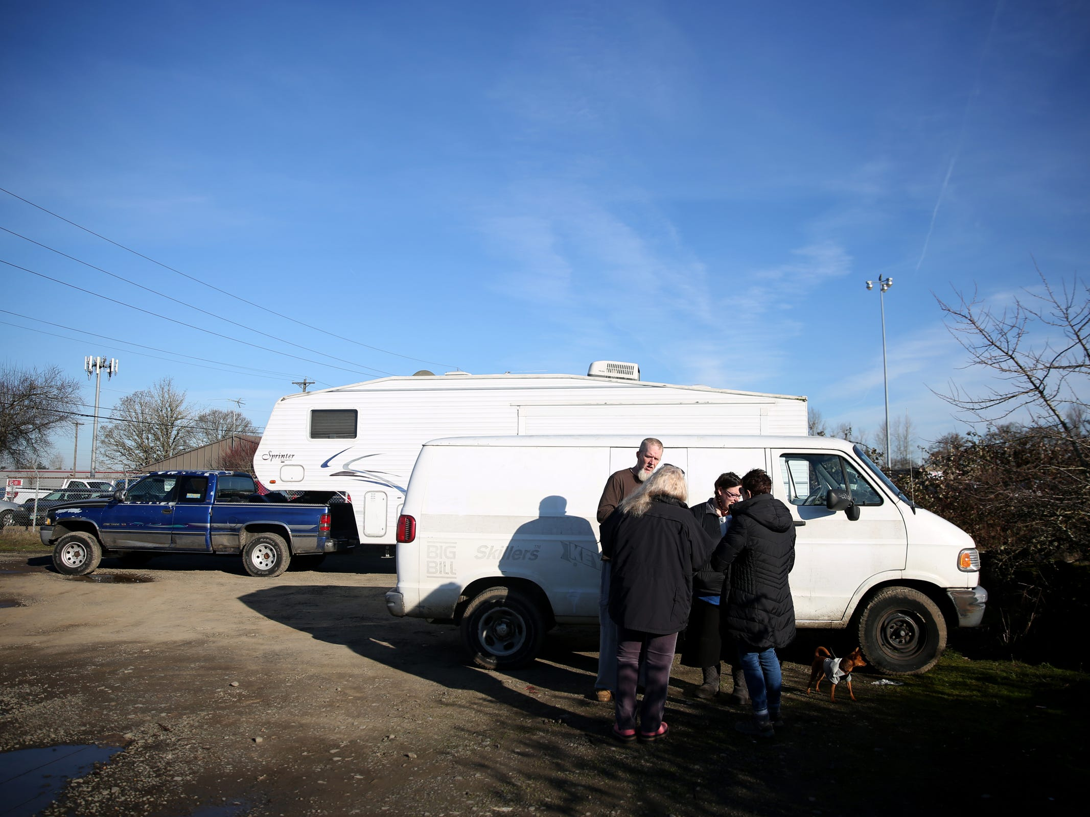 Aaron Webber, 43, and Cheyanne West, 24, give their information to volunteers Lorrie Walker and Pamella Watson outside the van they live in with their dog during the annual Point-in-Time homeless count in Salem on Wednesday, Jan. 30, 2019. The number of people counted helps local programs qualify for federal funds to combat homelessness.