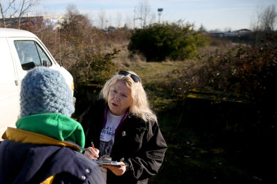 Volunteer Lorrie Walker gathers information from Dave West, 52, during the annual Point-in-Time homeless count in Salem on Wednesday, Jan. 30, 2019. The number of people counted helps local programs qualify for federal funds to combat homelessness. He lives in a travel trailer with his pregnant girlfriend and dog.