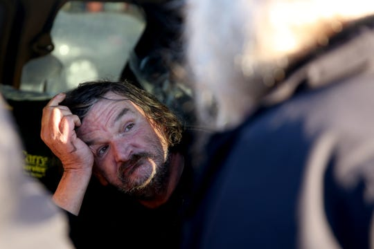 Leonard Wales, 59, gives his information to volunteer Lorrie Walker during the annual Point-in-Time homeless count in Salem on Wednesday, Jan. 30, 2019. The number of people counted helps local programs qualify for federal funds to combat homelessness. He lives in a minivan with another person and two dogs that was parked in the former Kmart parking lot.