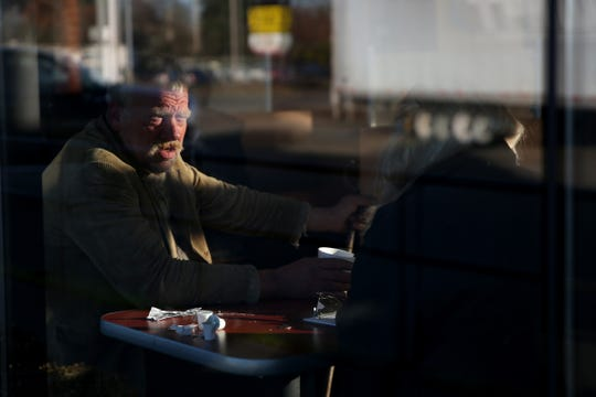 George Waltz, 56, gives his information to volunteer Lorrie Walker inside the Jack In The Box on Mission St. SE during the annual Point-in-Time homeless count in Salem on Wednesday, Jan. 30, 2019. The number of people counted helps local programs qualify for federal funds to combat homelessness.