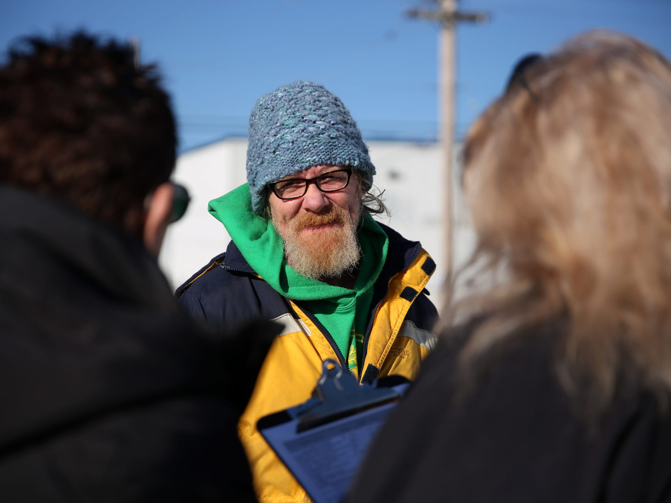 Dave West, 52, gives his information to volunteers Pamella Watson, left, and Lorrie Walker during the annual Point-in-Time homeless count in Salem on Wednesday, Jan. 30, 2019. The number of people counted helps local programs qualify for federal funds to combat homelessness. He lives in a travel trailer with his pregnant girlfriend and dog.