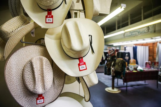Western hats on display at Serenity's Trading, 8 E. Concho Ave.