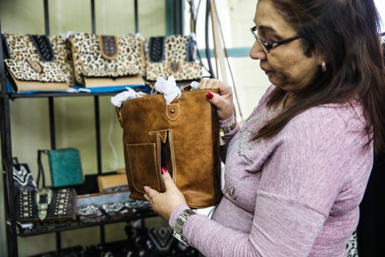 Patsy Cotton holds a purse with a conceal weapon pocket Jan. 24, 2019, at her shop Serenity's Trading, 8 E. Concho Ave.