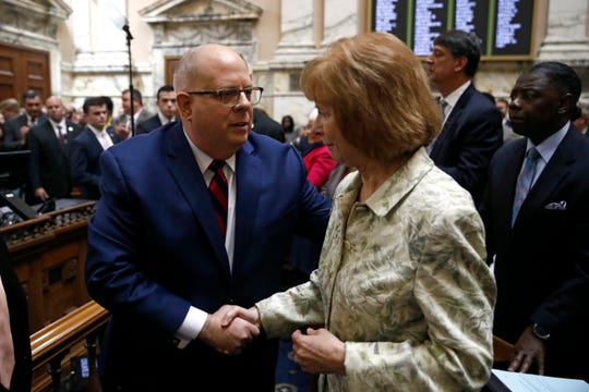 Maryland Gov. Larry Hogan, left, shakes hands with Sen. Kathy Klausmeier, D-Baltimore County, after delivering his annual State of the State address to a joint session of the legislature in Annapolis on Wednesday.