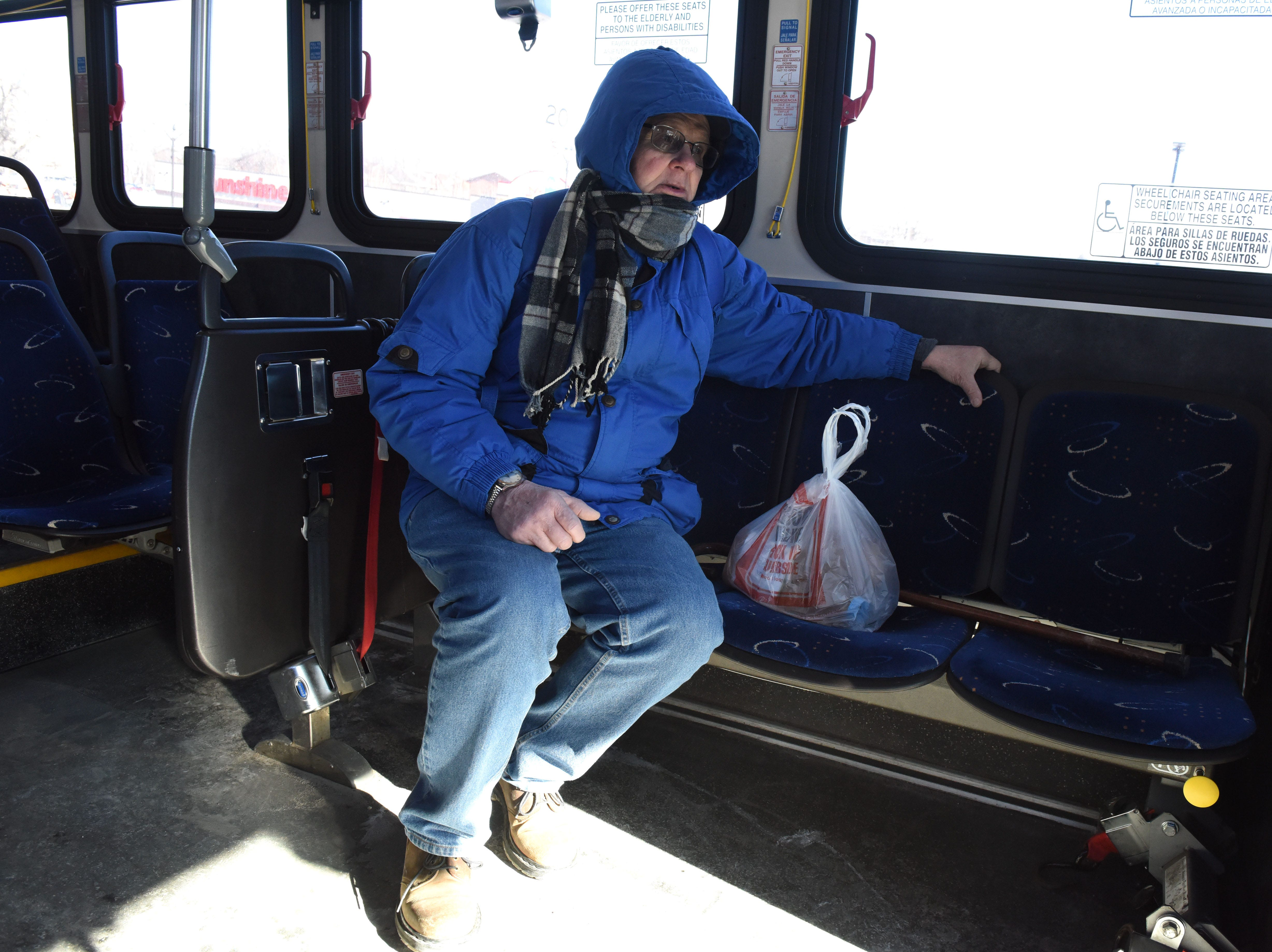 James Coleman rides the bus in Sioux Falls, S.D., Wednesday, Jan. 30, 2019.