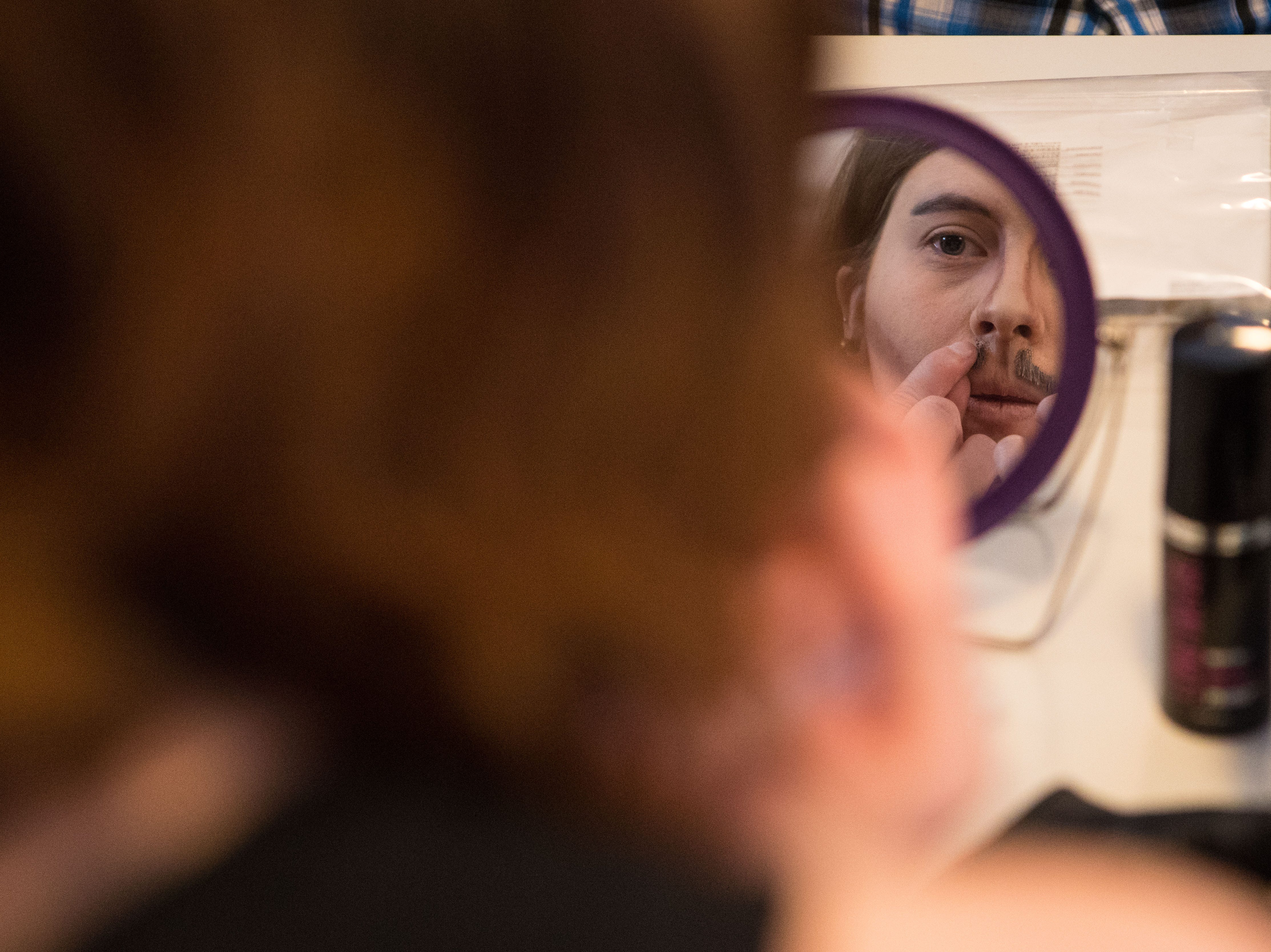 Ashlee Reck (drag name: Oliver Clozoffin) puts her mustache on during drag king rehearsal in Sioux Falls, S.D., Saturday, Jan. 26, 2019.