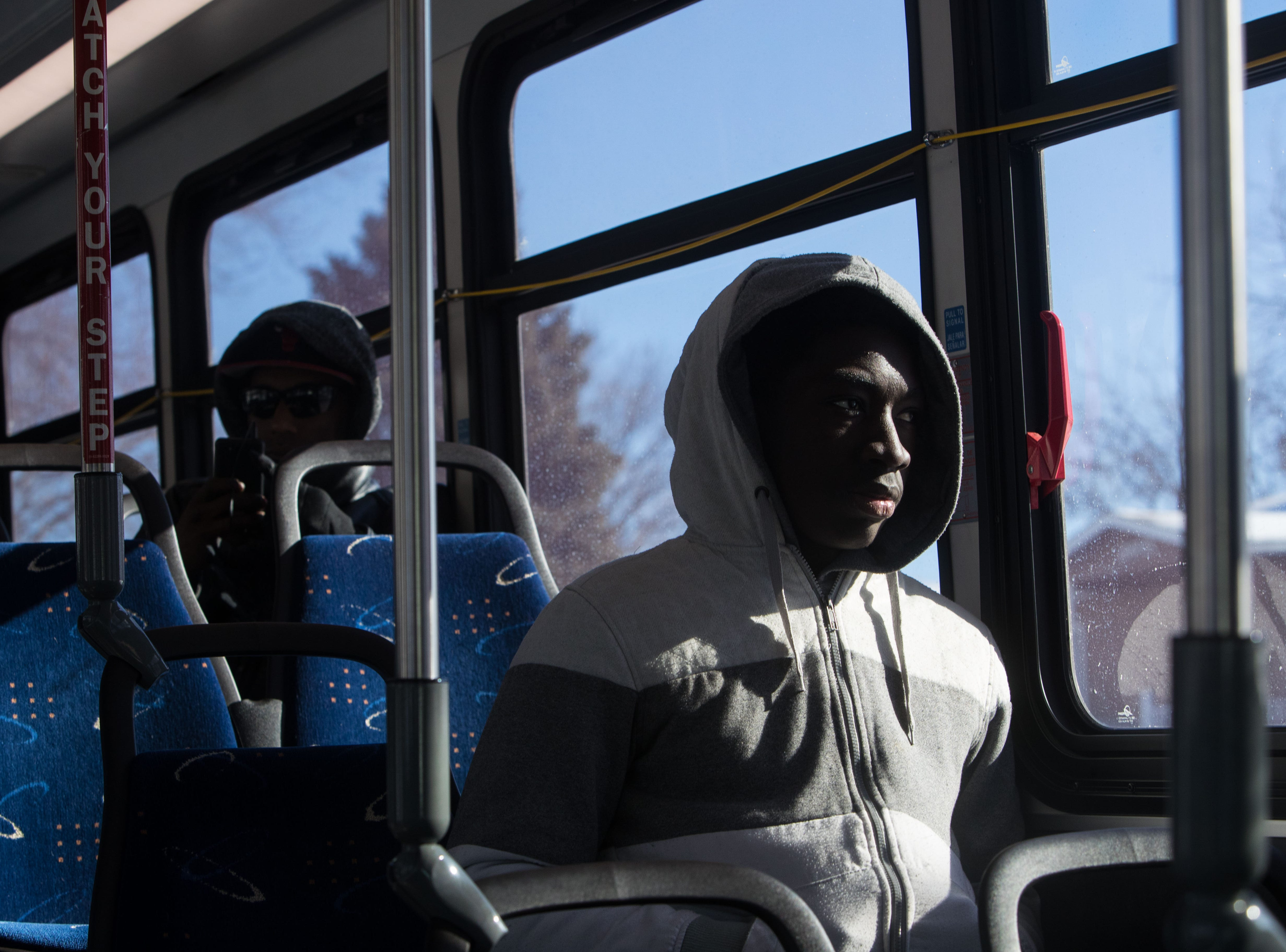 Nelson Freeman, 16, rides the bus in Sioux Falls, S.D., Wednesday, Jan. 30, 2019.