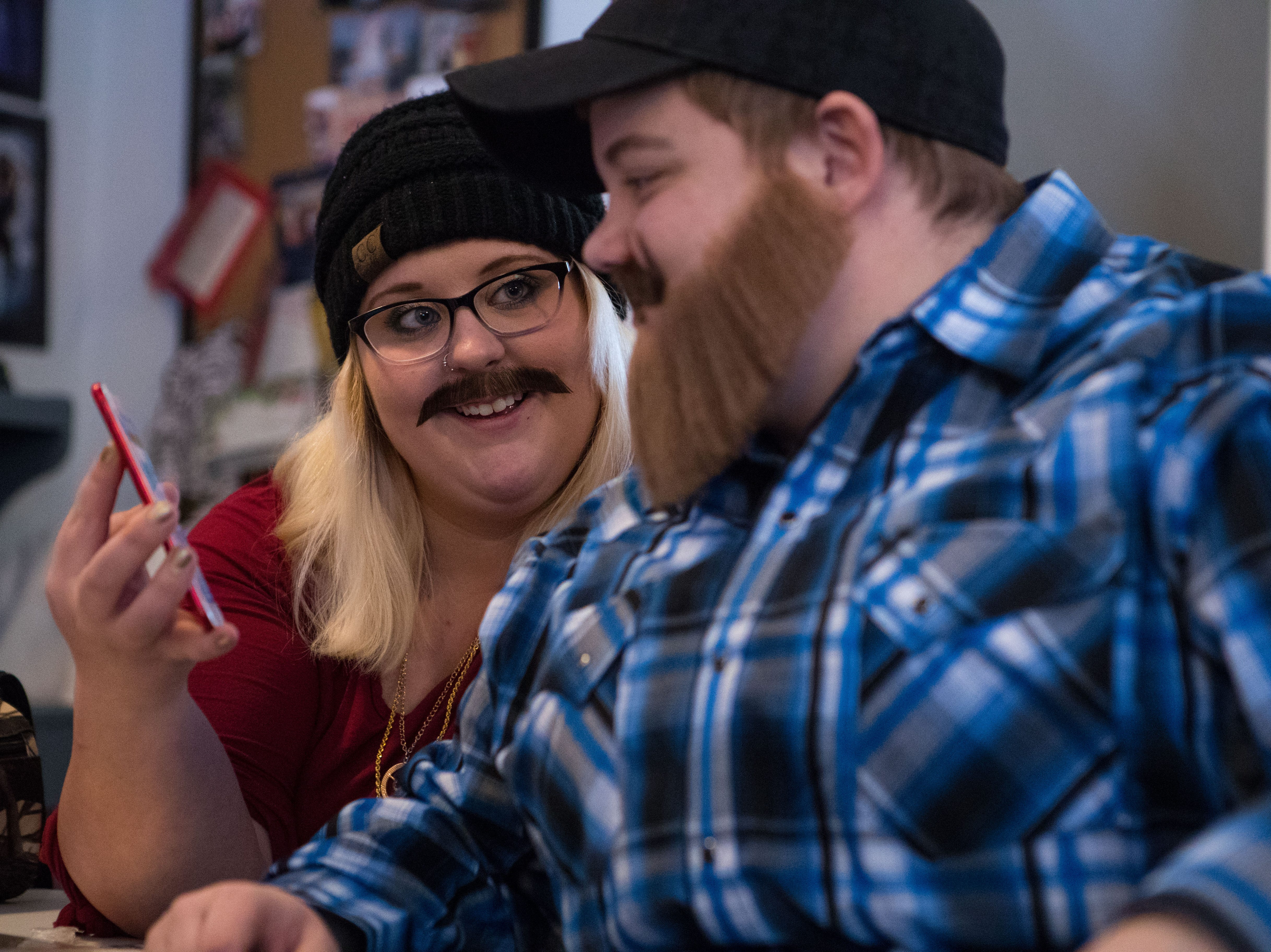 Jenna Askelson (left) and Kayla Harris (drag name: Sexton Urmum Valentine) react during the drag king rehearsal in Sioux Falls, S.D., Saturday, Jan. 26, 2019.