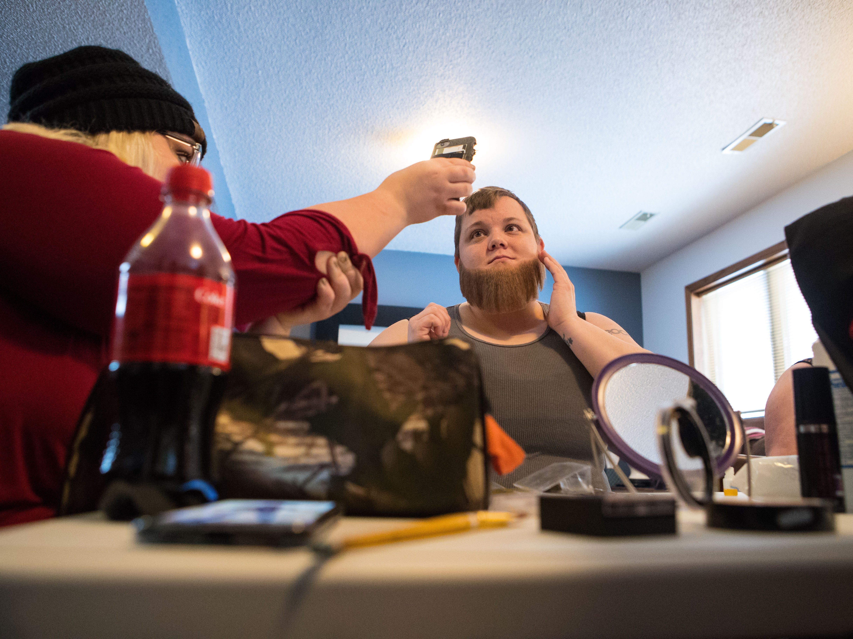 Kayla Harris (drag name: Sexton Urmum Valentine) puts her beard on during the drag king rehearsal in Sioux Falls, S.D., Saturday, Jan. 26, 2019.