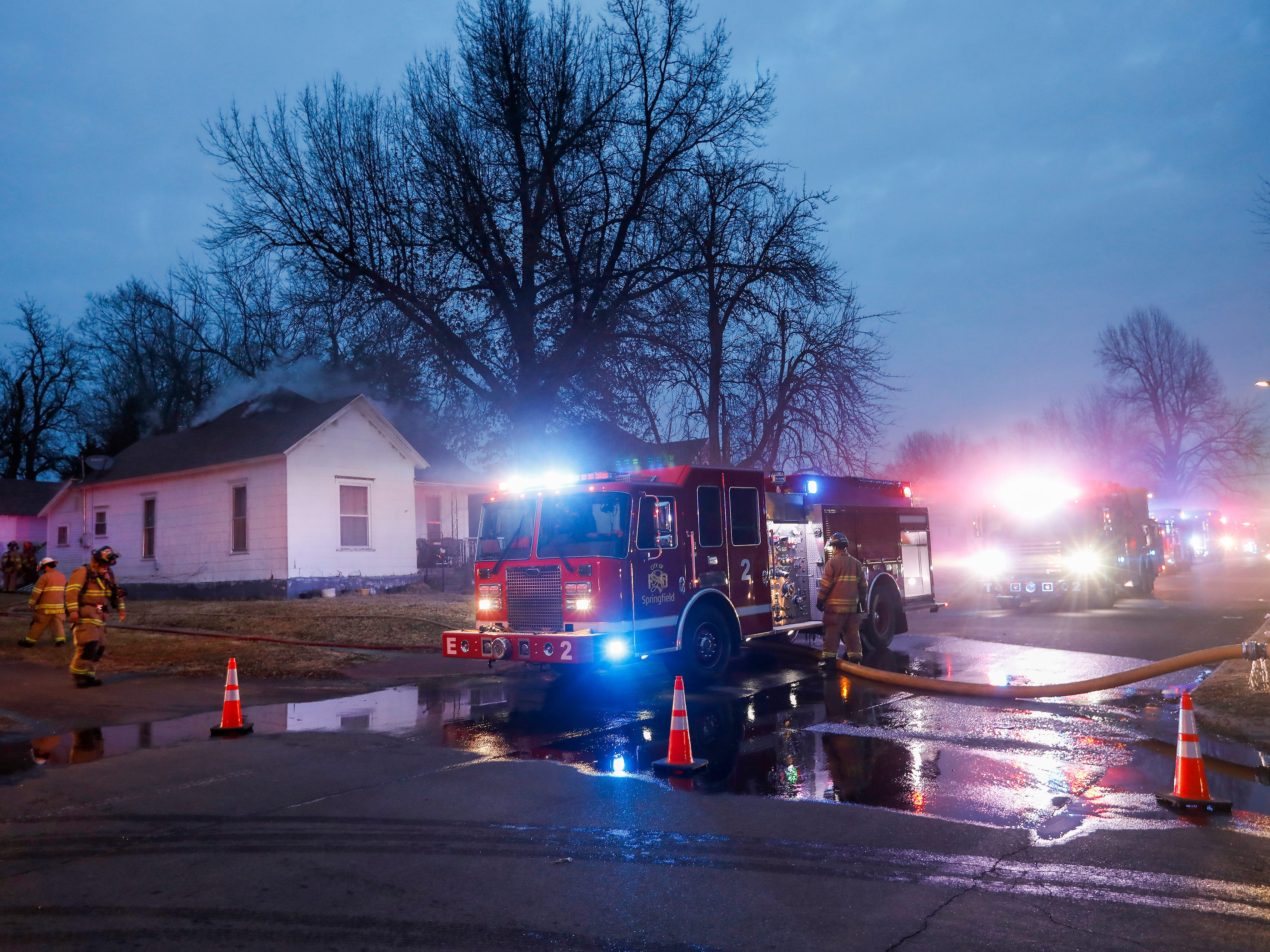 Firefighters work to extinguish a fire that started in the attic of a home on the 1000 block of Hovey Street on Tuesday, Jan. 29, 2019. The homeowners were home at the time of the fire and got out without injury.