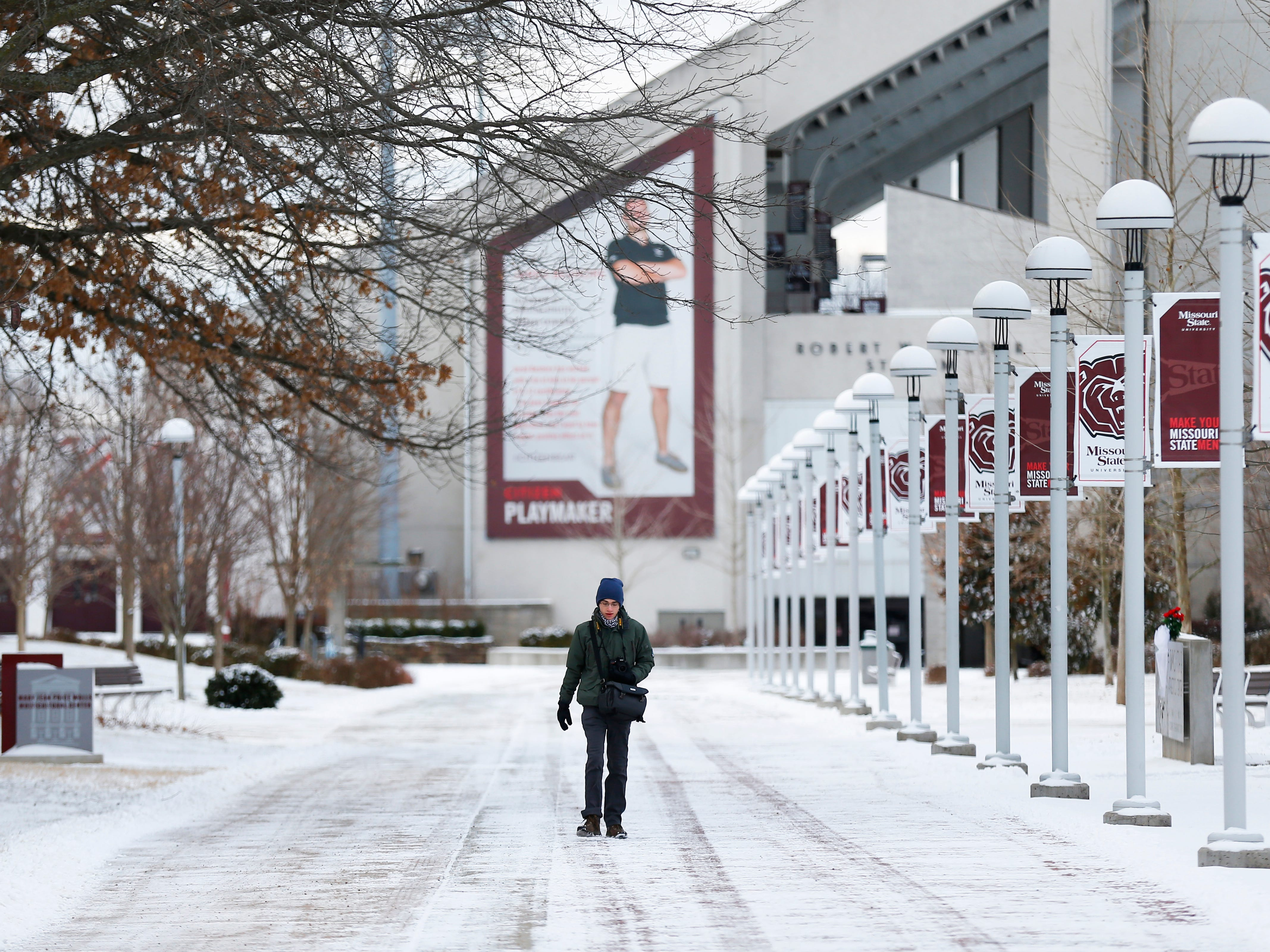 A student walks across a snow covered path on the campus of Missouri State University Wednesday morning, January 30, 2019.