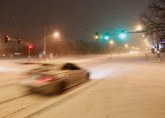 Snow falls and covers the roads at Jefferson Avenue and Battlefield Road on Tuesday evening.